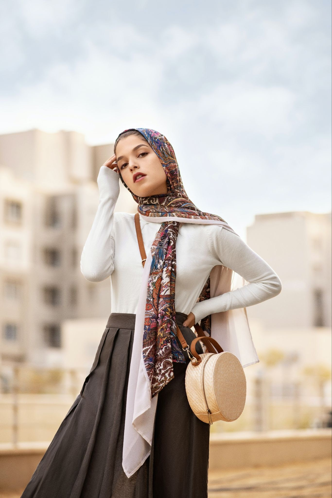 A woman creating a statement look with layered headscarves